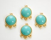 Acrylic Turquoise Cabochon in 4 Loop Gold Tone Setting pnd162C
