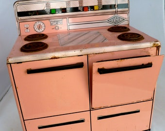 SALE 1950s Childs toy stove by Wolverine - Pink and Black