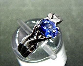 AAA Blue Ceylon Sapphire   6.5x5mm  .81 Carats   14K white gold Infinity Bridal set.