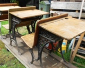ANTIQUE SCHOOL DESKS, 3 wooden student desks on rail, iron detail, rustic patina