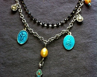 Virgin Mary Divine Child Crucifix in turquoise yellow black rhinestones glass pearls necklace