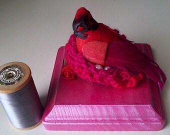 Miss Valentine, Cardinal in a nest figure