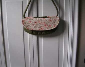 Purse with green dot main body and flowered flap