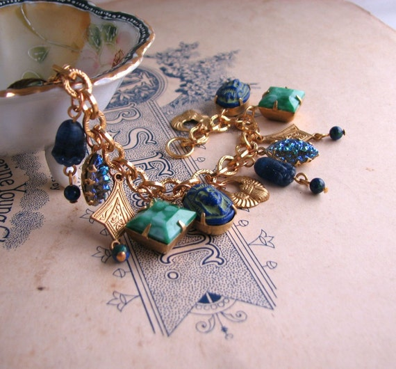 Egyptian Revival charm bracelet with vintage lapis blue and jade art glass