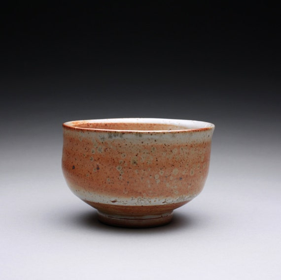 chawan, tea bowl, pottery bowl with layered orange shino glazes