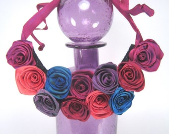Bib statement necklace of ribbon roses -- French ribbon roses in red and purple -- a floral centerpiece that will never wilt