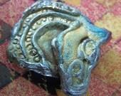 27. Celtic Horse Raku Cabochon
