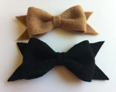 Set of 2 wool felt bows in camel and black.