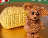 Crocheted miniature mouse with cheese wedge