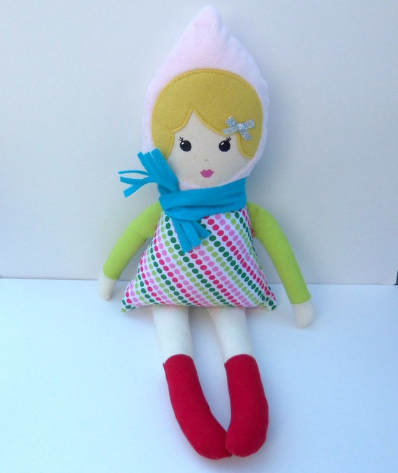 cloth rag doll with winter clothes and scarf, red socks and blonde hair