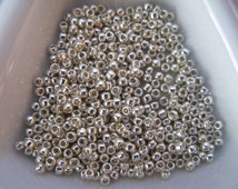 Toho 15/0, size 15 round Permanent Finish Galvanized Silver Seed Beads (color P470/TP558)  approximately  28 Grams