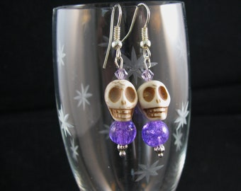 Stone Skull with purple swirly bead and purple Swarovsky crystals. sterling dangle earrings