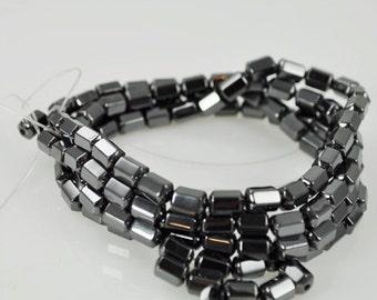 41 Magnetized Hematite Beads - Octagon Shaped Barrel