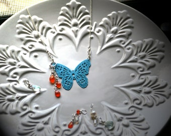 Miracle: Turquoise Color Coated Brass Lacy Butterfly Stamping On Sterling Silver With 8 Dangles
