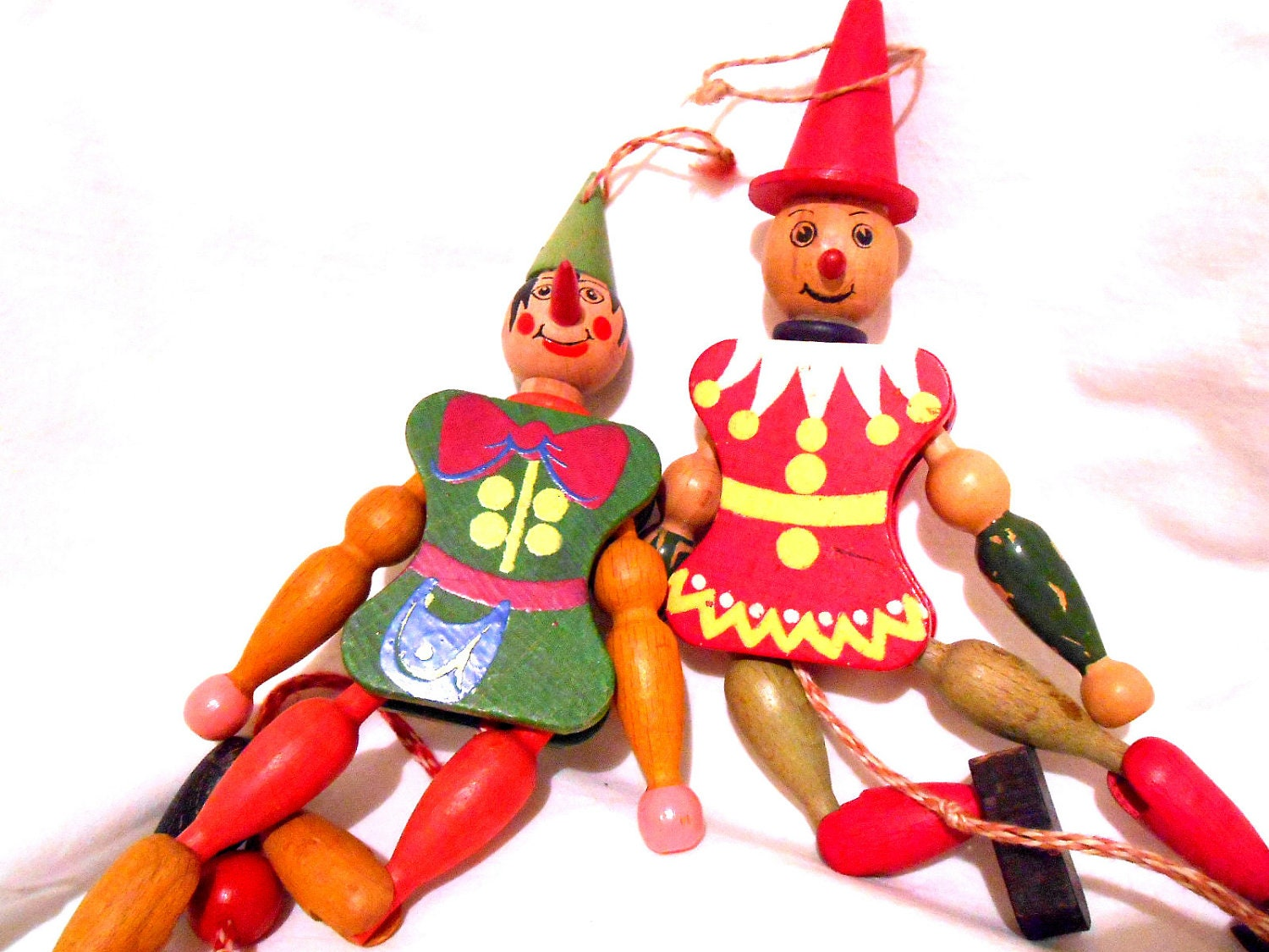 Vintage pair of wooden jumping jack christmas ornaments toys