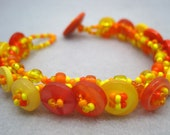Beaded Button Bracelet - Tropical Sorbet Yellow Orange Bright Vivid by randomcreative on Etsy