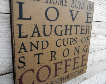 This Home runs on Love Laughter and cups of strong coffee wood sign