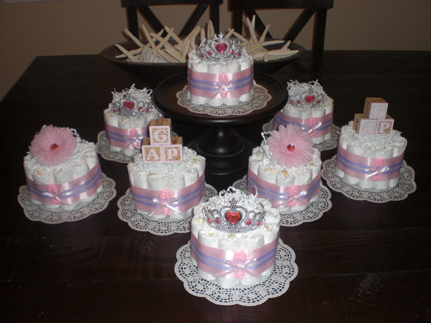 Pink and purple bundt baby shower centerpieces diaper cakes