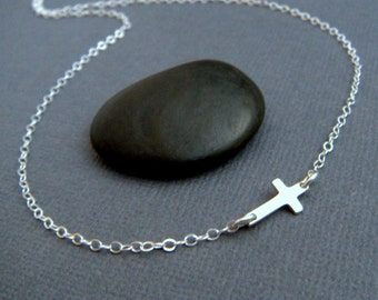 sideways cross necklace. OFF CENTER. sterling silver. TINY silver cross necklace off centered. asymmetrical. simple. dainty. delicate.