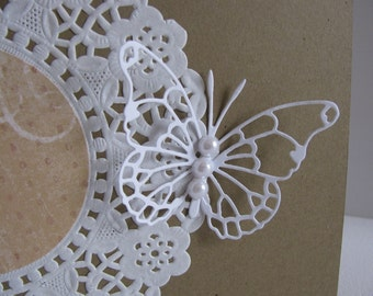 INVENTORY CLEARANCE White Lacy Butterfly & Imperfect Paper Doily on Kraft Card. Butterfly Adorned with 3 Faux White Pearls. A2 Size