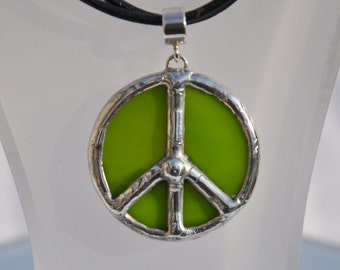 Green stained glass peace pendant