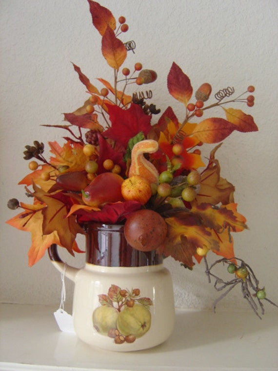Autumn Color Leaves and Fruit in a Golden Apple Teapot - OOAK Floral Arrangement offered by an EtsyMom