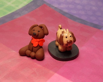 2 Handmade Polymer clay Figurines Brown Dog with red bow and Brown Spotted dog with wood base
