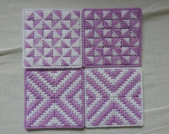 lilac and white set of four plastic canvas coasters