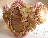 Romantic powder pink bracelet cuff with jasper cabochon, lucite and 24K goldplated beads and findings.