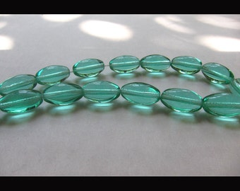 "Green Glass Oval Beads - 11"" Strand"