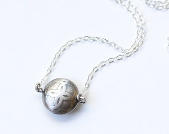 "Dainty sterling silver necklace of a solitary bead artisan made of two domed, textured and soldered silver sheet circles - ""Token Necklace"""