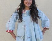 origami sculpted hand dyed blue linen pleated top with ikat slices