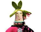 Textile cloth art doll with  a rose bud on top of her head