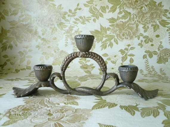 A Hobbits candle holder, oak leaves, acorn caps and wheat grain knot