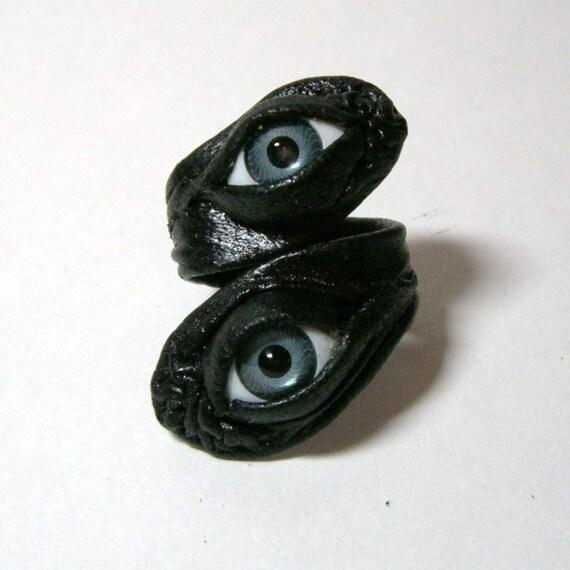 Evil eye adjustable black leather ring. halloween ring