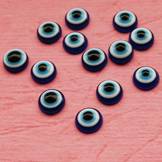 13 vintage plastic eye cabochons