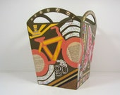 collaged container with handles... use it to hold trash, linens, laundry...  decorated with bicycles, butterflies, inspirational