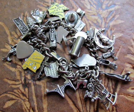 HOLD for Felicity HUGE and HEAVY 32 Charm Mostly Cowboy and Indian Themed Sterling Silver Charm Bracelet, with Charms