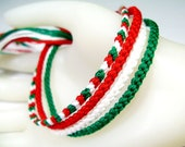 Four Handmade Friendship Bracelets in Red, Green, and White