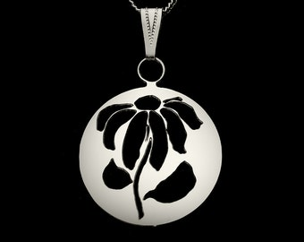 Daisy or Poinseitta Floral cut out circle pendant, silver plated necklace