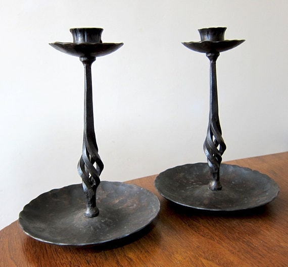 Hand wrought iron candlestick holders  arts and crafts  era