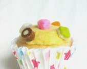 Cupcake with Lemon icing and dolly mixtures