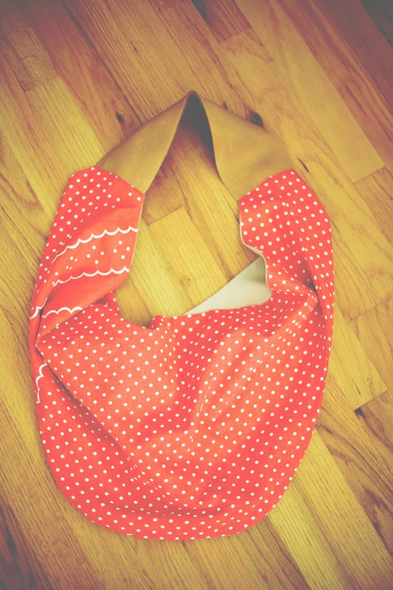 large hawthorne tote in vintage red dotted canvas with wide leather strap
