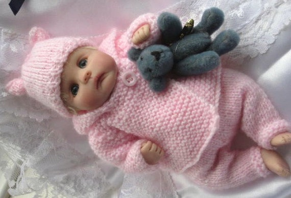 Knitting Patterns For Baby Layettes : Snow Baby Layette Knitting pattern for baby doll 7-8 inches