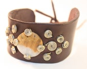 Wide leather cuff bracelet with petrified wood stone and alpaca wire detail