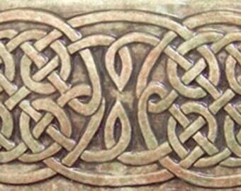 Relief carved Celtic ceramic art tile border