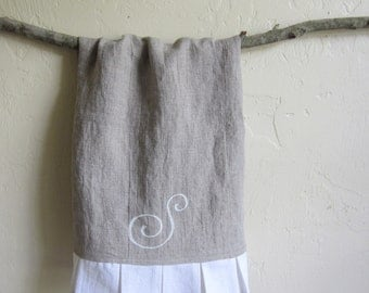 Monogrammed linen guest towel with white ruffle