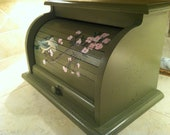 bread box in oregano green with  bird sitting on pink apple blossom tree branches hand painted on roll top door