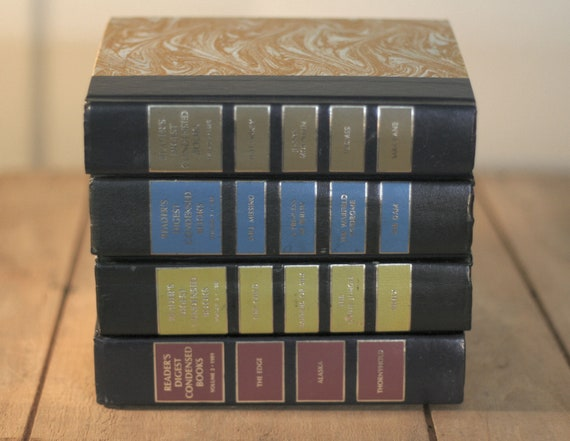 set of four readers digest books with graphic covers