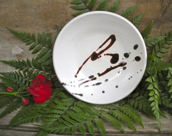 White Plate with Splashes of Rich Red